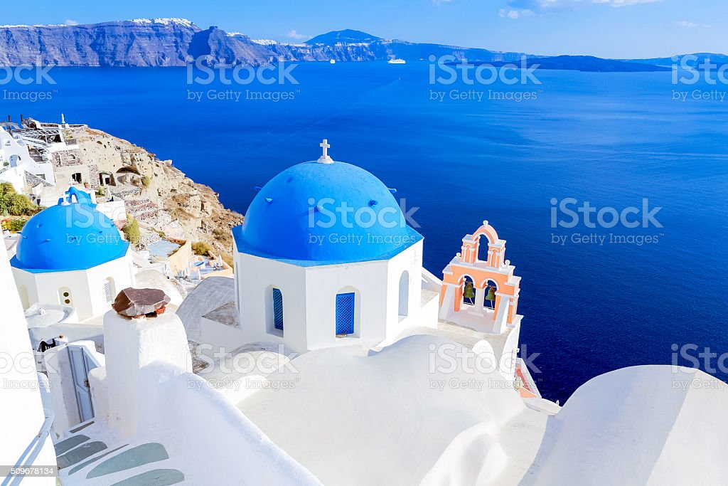 Santorini blue dome churches stock photo
