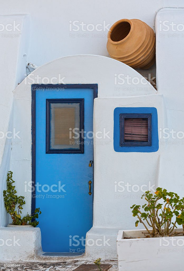 Santorini blue door on Greece stock photo
