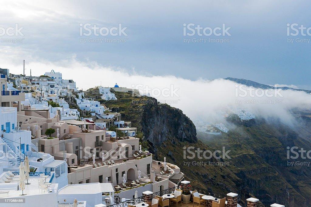 Santorini buildings in the fog stock photo