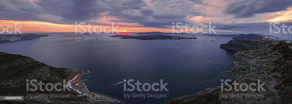 Santorini caldera and volcano at sunset stock photo