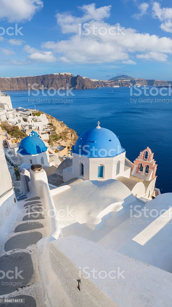 Santorini church bell tower and dome in Oia on Greece stock photo