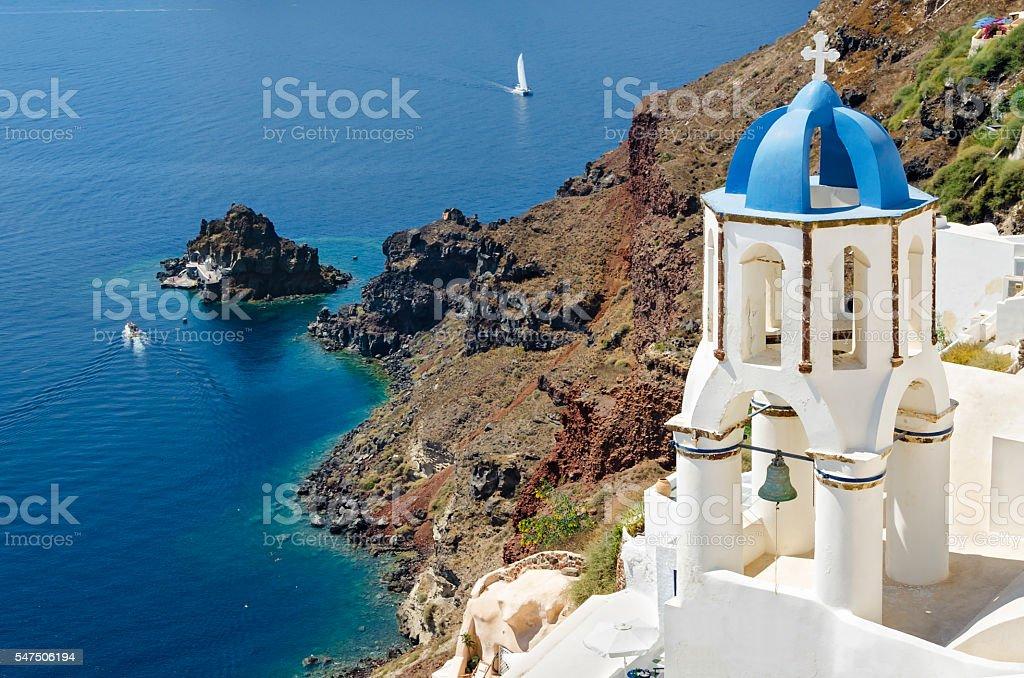 Santorini classic view with white belfry - Oia, Greece stock photo