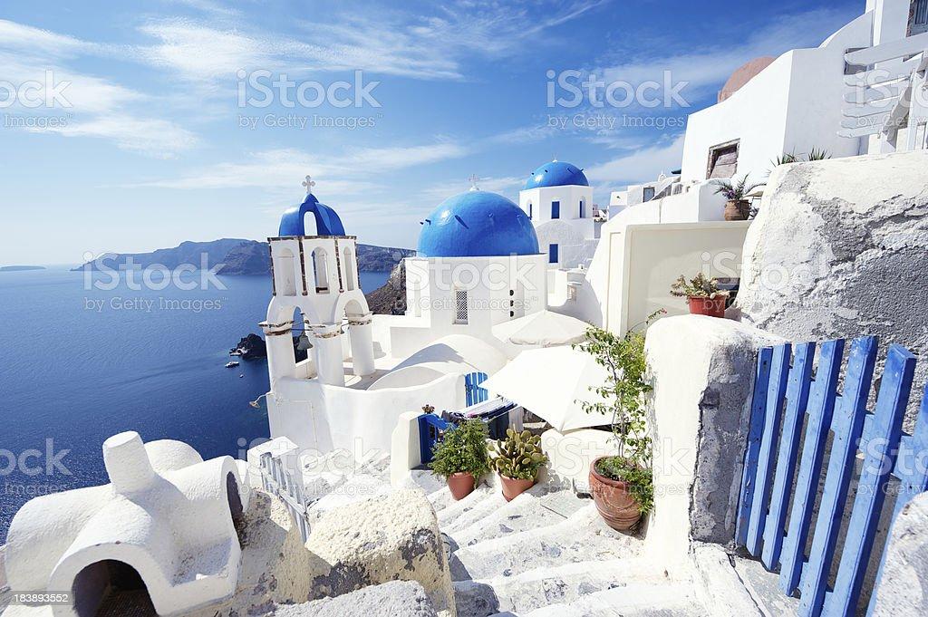 Santorini Greece Bright Morning Blue Gate Overlooking Mediterranean Sea stock photo