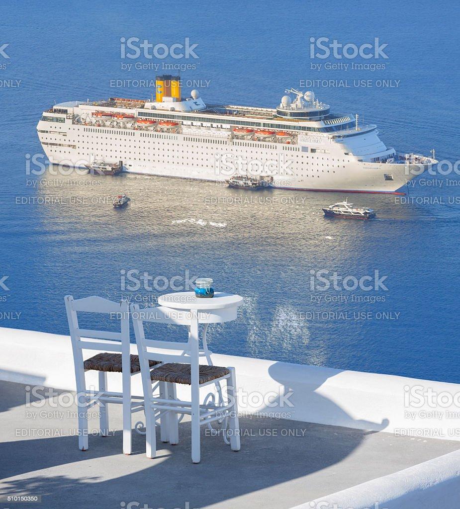Santorini Greece cruise ship seen from restaurant stock photo