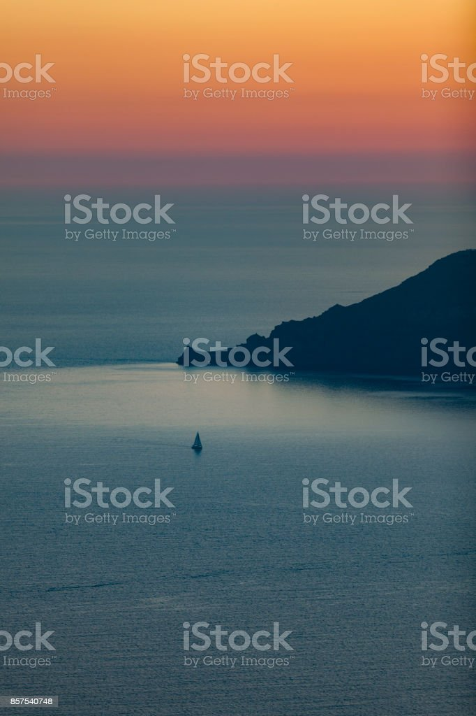 lonely sailing ship at sunset, santorini islands, the cyclades,...