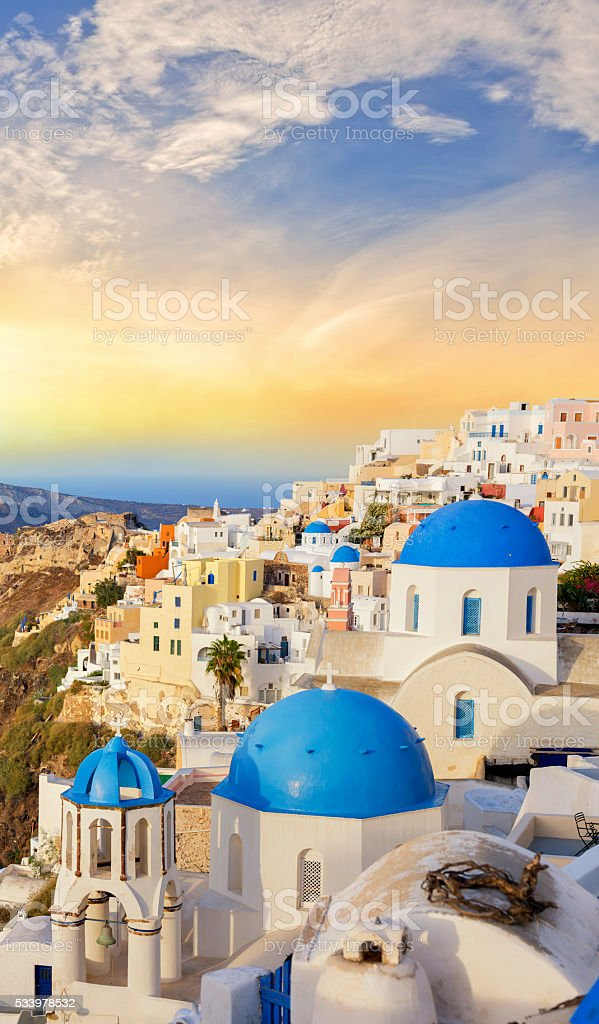 Santorini sunset over the village of Oia in Greece stock photo