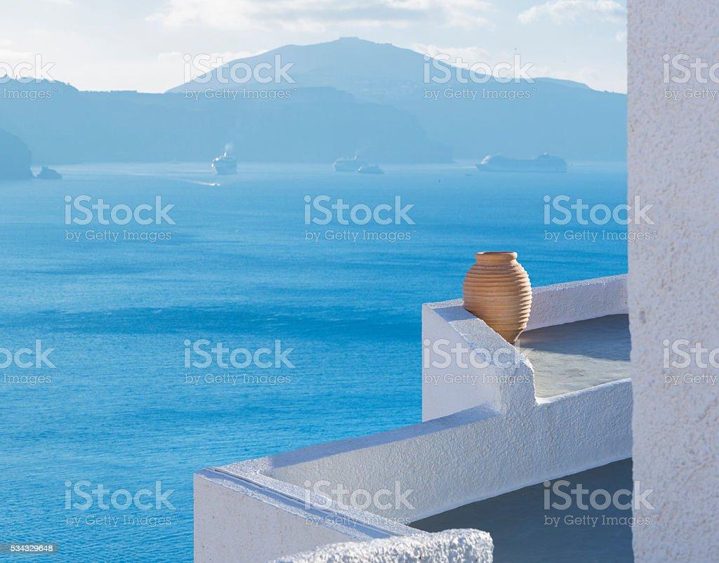 Santorini terrace with amphore in Oia Greece stock photo