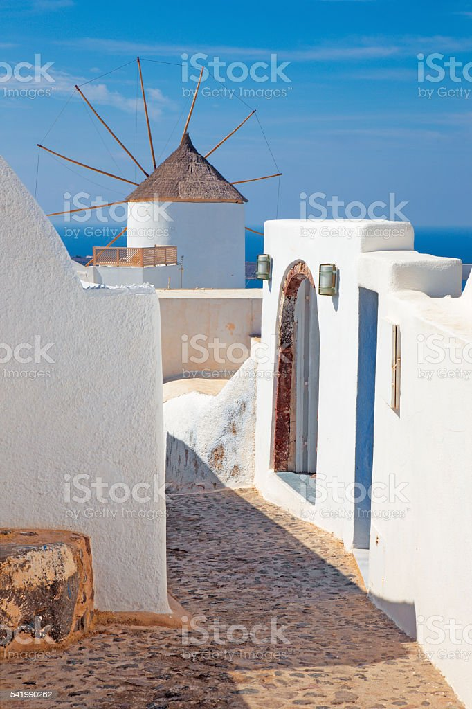 Santorini - The ailse and windmill in Oia. stock photo