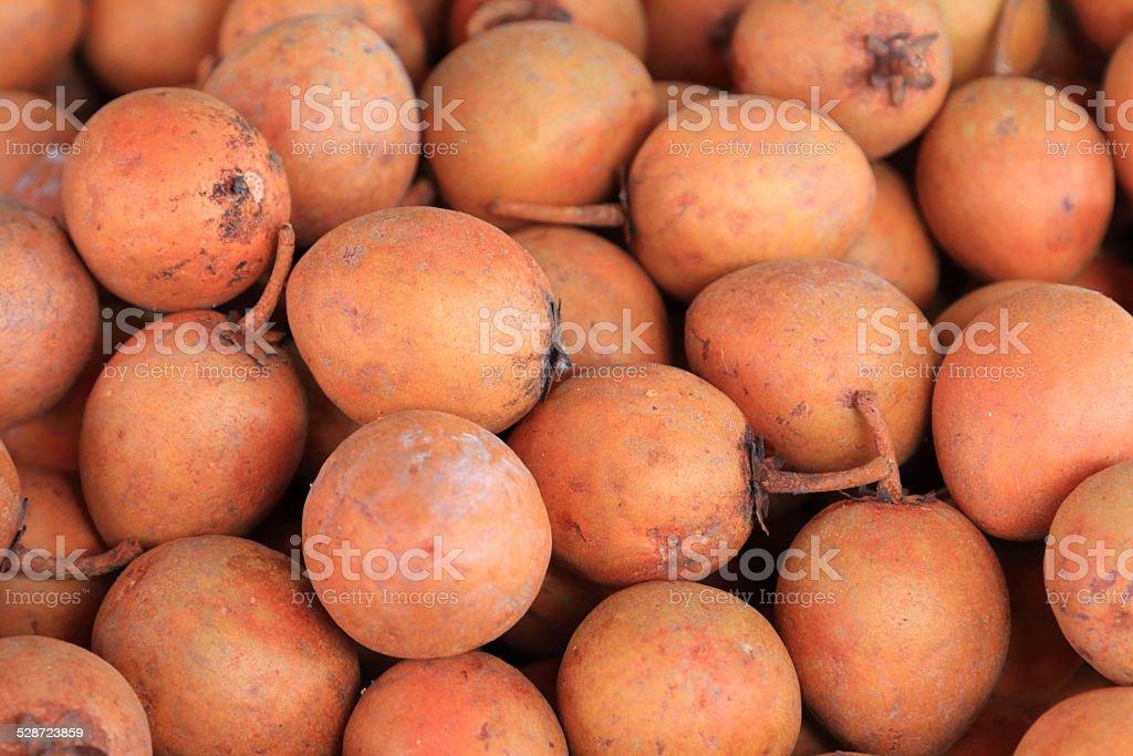 Sapodilla plum in market stock photo