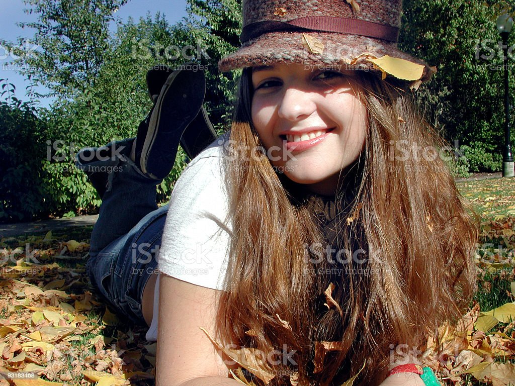 Sarah in the leaves royalty-free stock photo