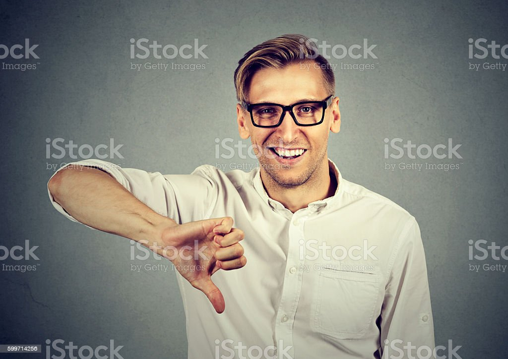 sarcastic man showing thumbs down sign happy stock photo