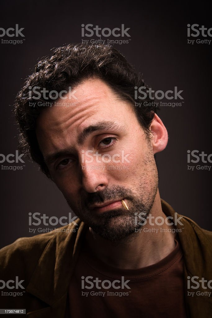 Sarcastic man with toothpick in mouth stock photo