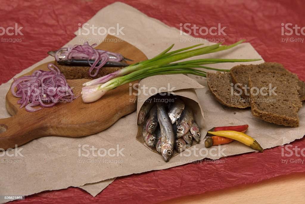 sardine with spring and red onion stock photo