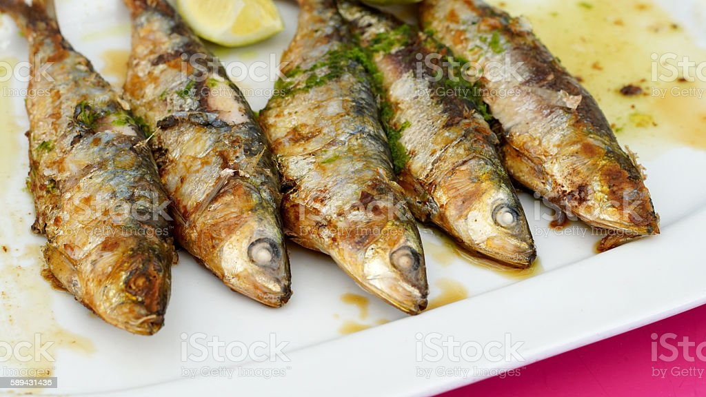 Sardines - grilled with oil, garlic and parsley stock photo