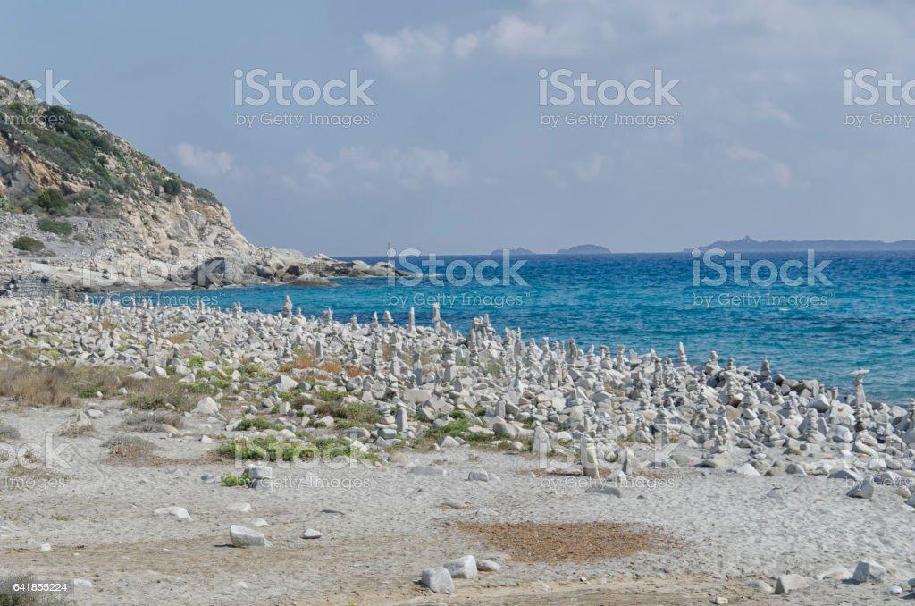 Sardinian beach with stone monuments stock photo