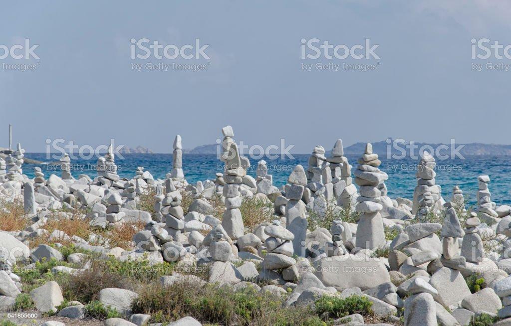 Sardinian beach with stones art work stock photo