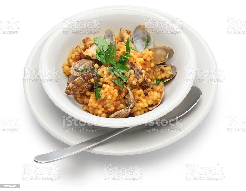 sardinian pasta fregula with clams, italian cuisine stock photo