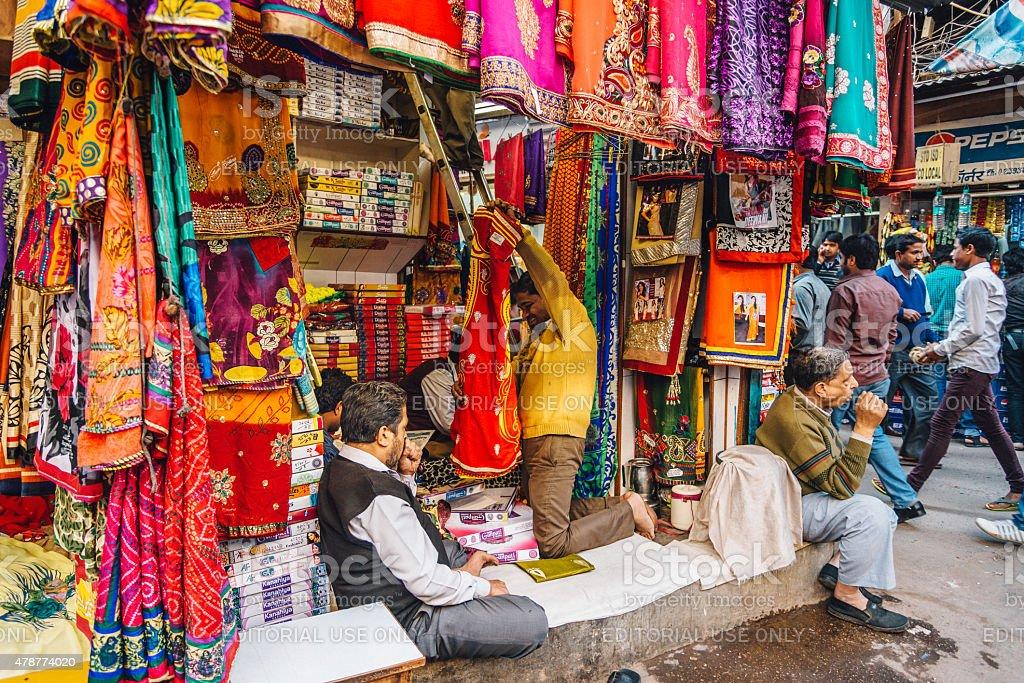 Sari shop on a street in old Delhi, India stock photo