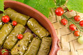 Sarma rolls in a traditional plate and cherry tomato