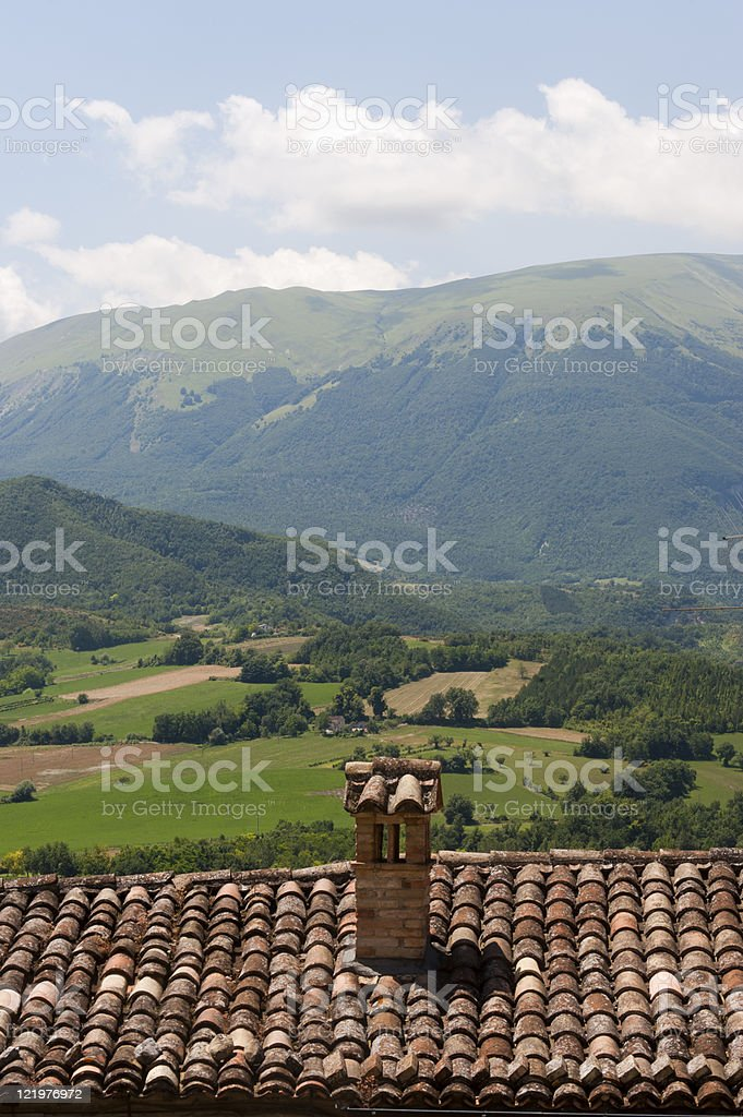 Sarnano (Macerata, Marches, Italy) - Landscape over a tiled roof stock photo