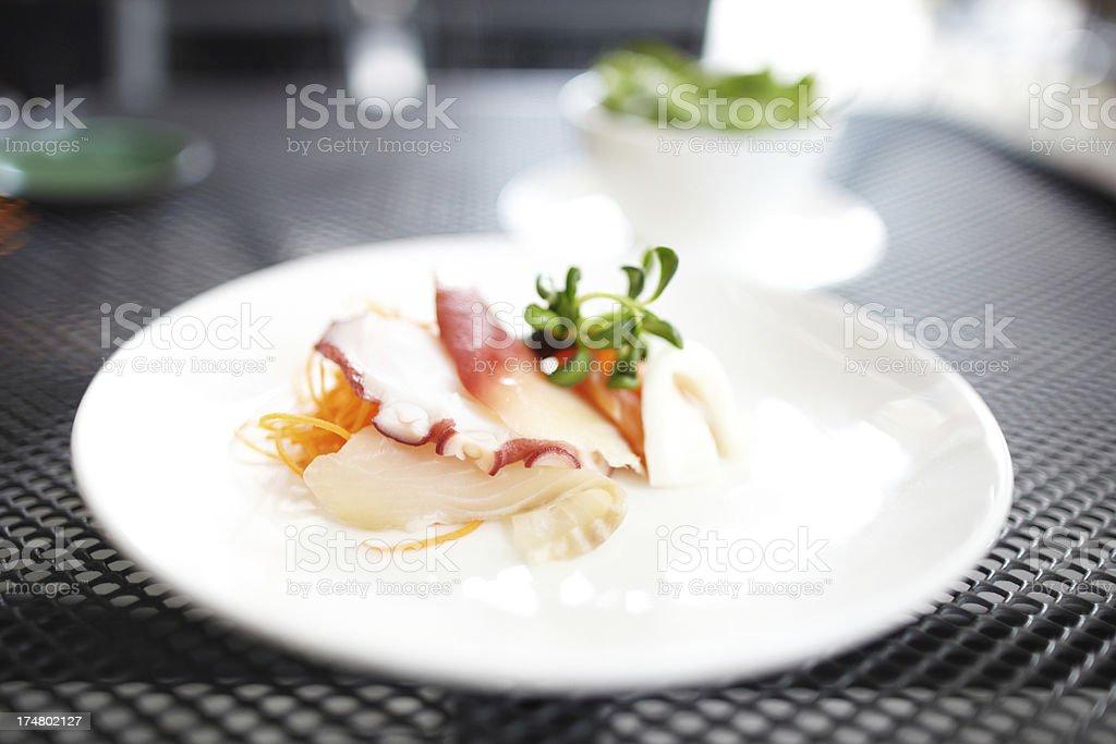 Sashimi on plate outdoors stock photo