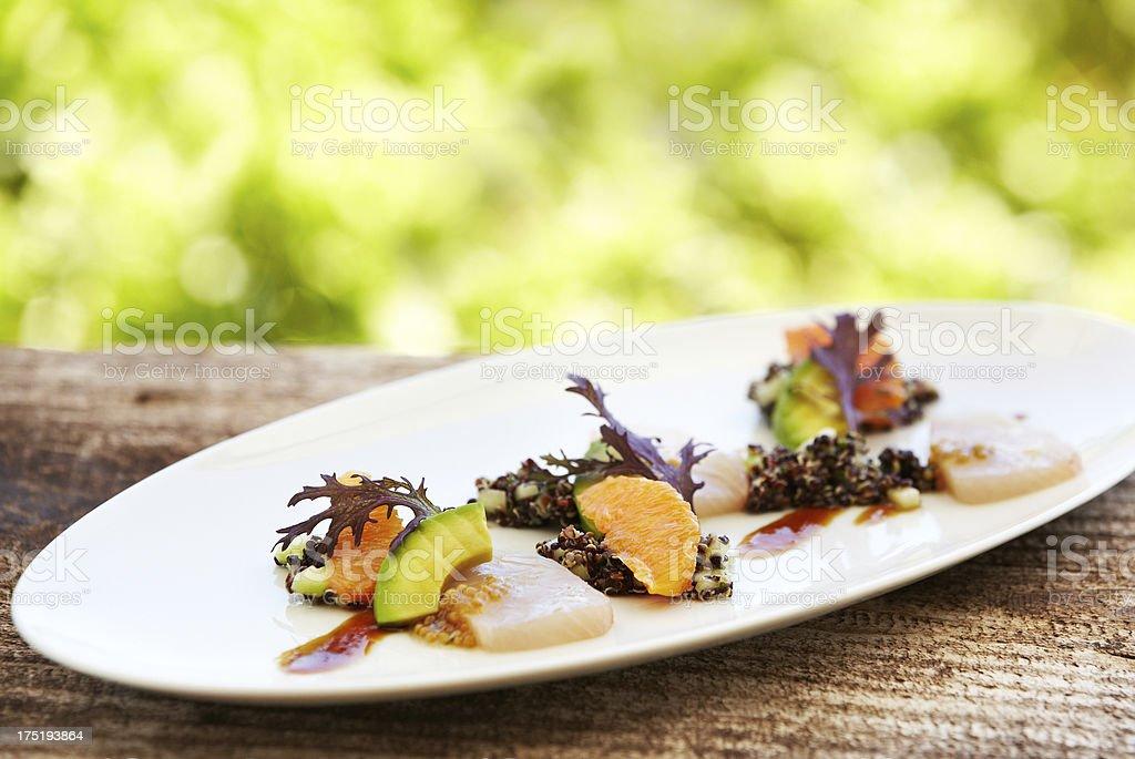 Sashimi with kale leaf, orange, avocado and quinoa stock photo
