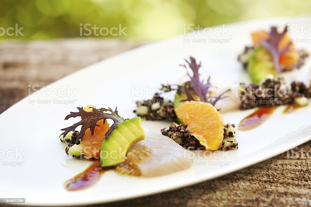 'Sashimi with kale leaf, orange, avocado and quinoa' stock photo