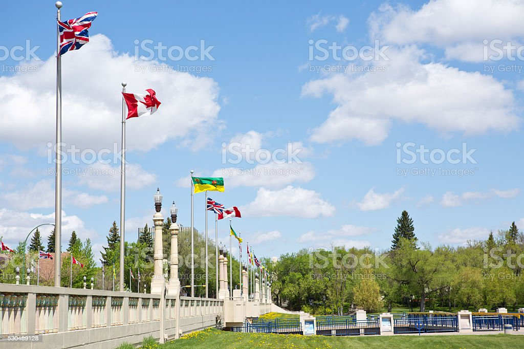 Saskatchewan British Canadian flags on Albert Memorial Bridge Victoria Day stock photo