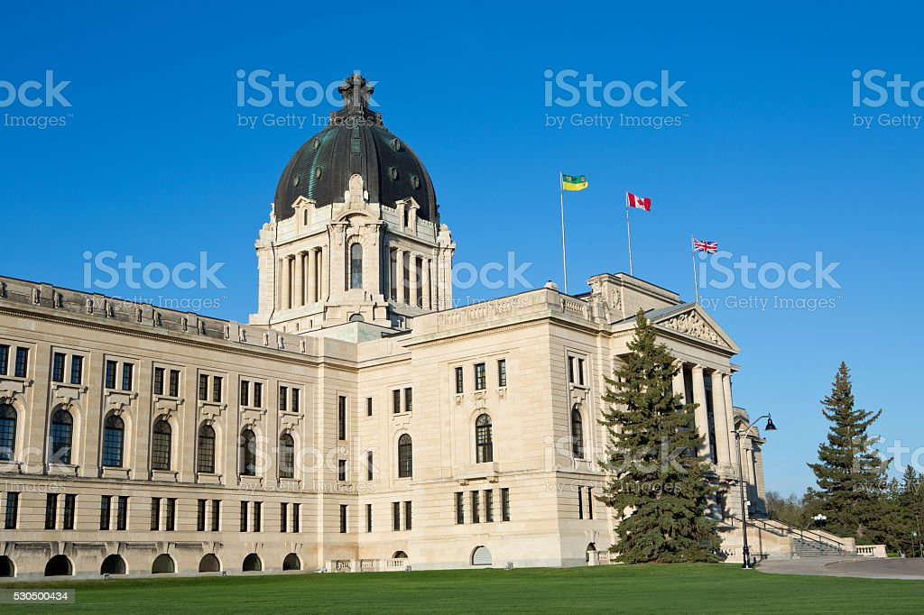 Saskatchewan Legislative Building with flags flying stock photo