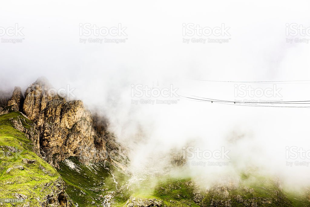 Sass Pordoi in low cloud stock photo