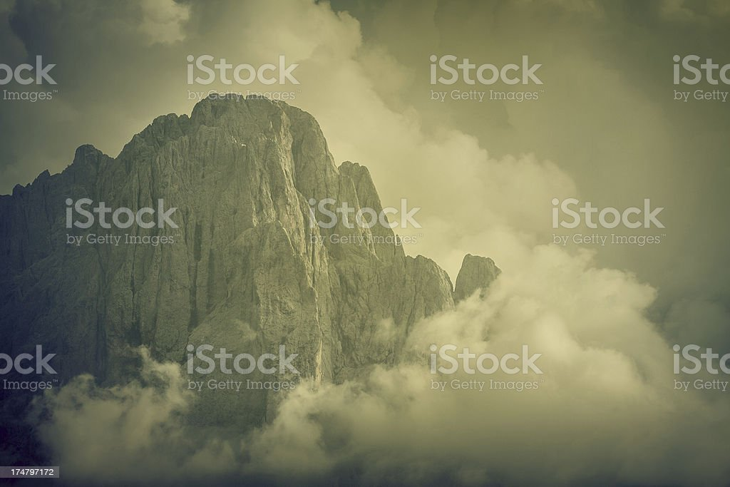 Sasslong mountain immersed in clouds stock photo
