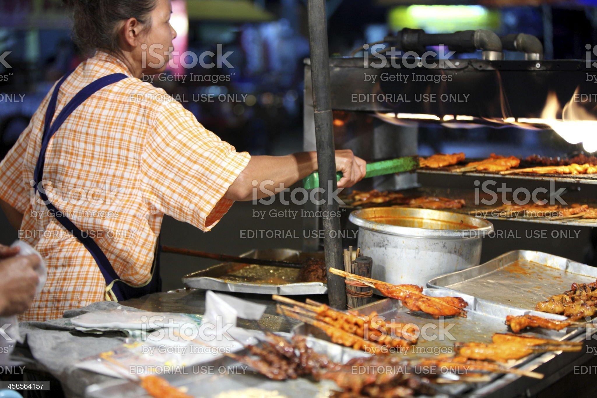 Satay skewers seller in Chiang Rai, Thailand royalty-free stock photo