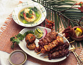 Sate (Indonesian style baked bread) and shrimp soup Indonesian cuisine