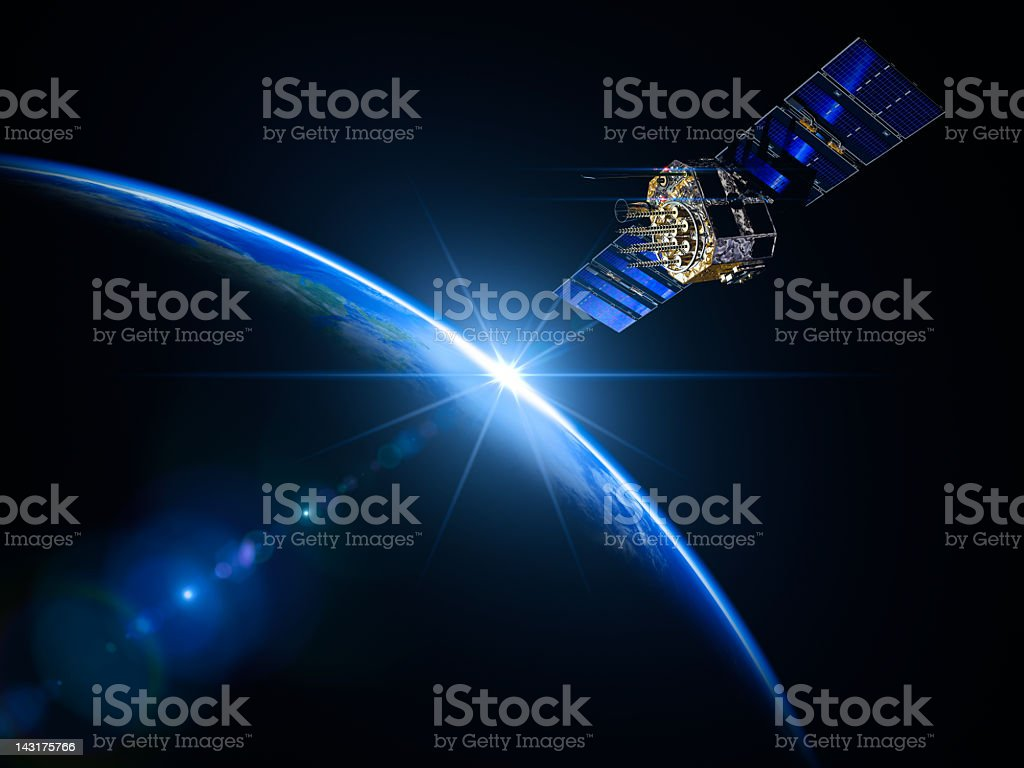 Satellite And Sunrise In Space stock photo