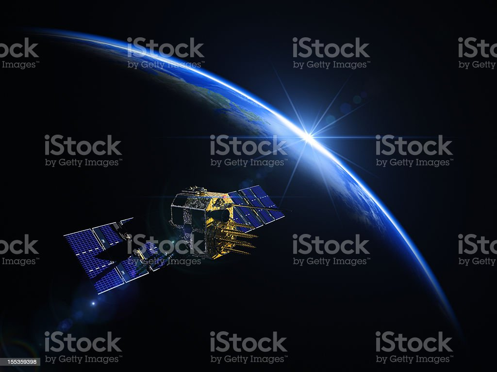 Satellite And Sunrise In Space royalty-free stock photo