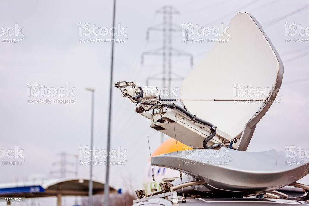 Satellite antenna mounted on television van stock photo