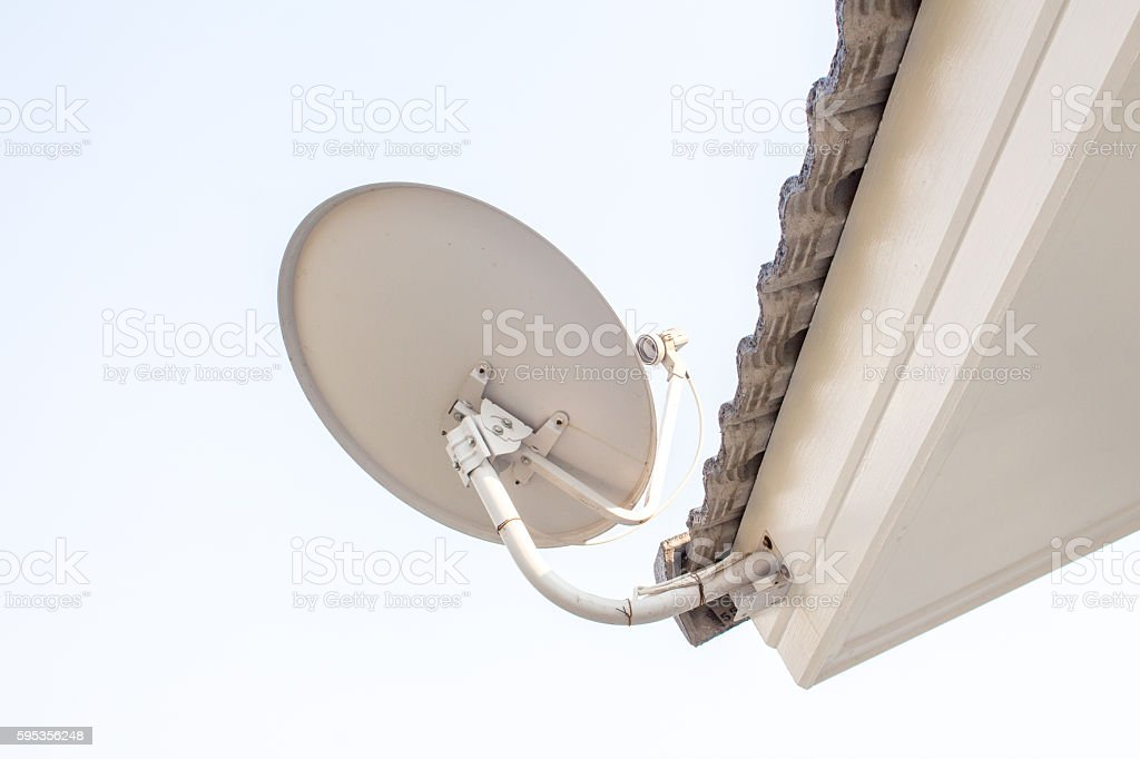 satellite antenna on the roof house stock photo