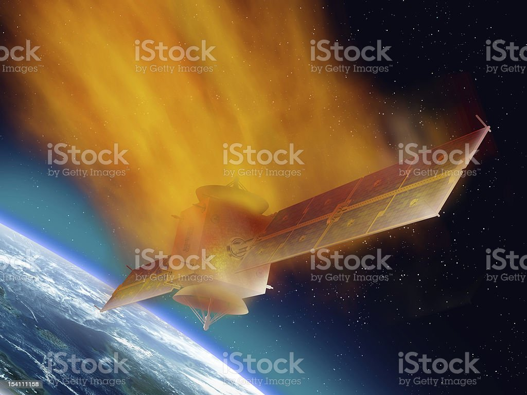 Satellite burning as it returns from space stock photo