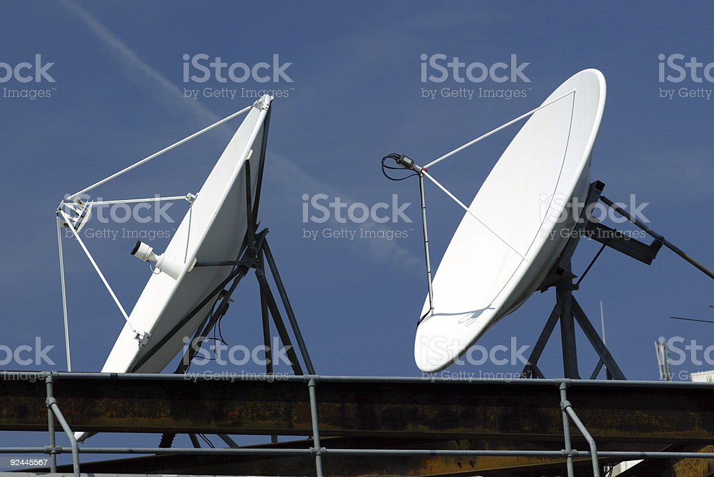 Satellite Communications Dishes on roof royalty-free stock photo