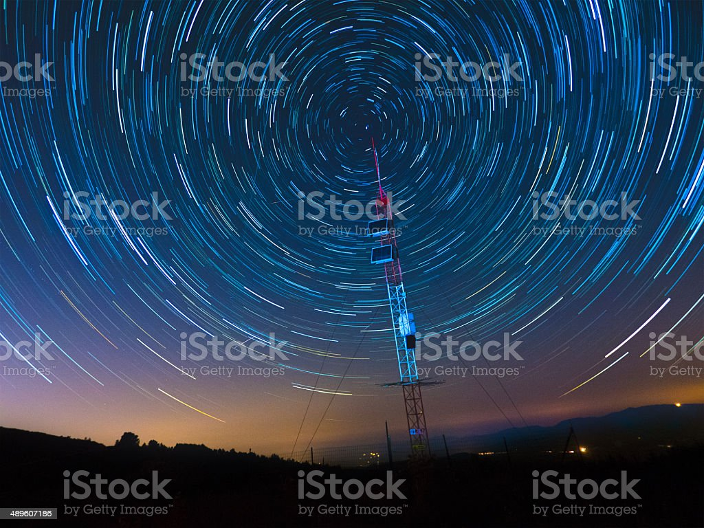 Satellite Communications Under A Starry Sky stock photo