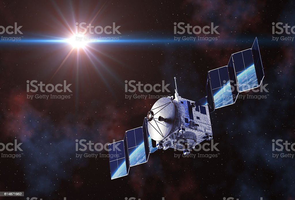 Satellite Deploys Solar Panels And Earth Reflected In Them stock photo