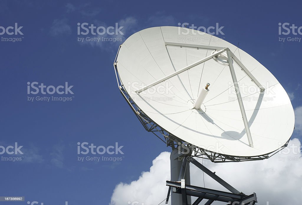 Satellite dish against sky and clouds royalty-free stock photo