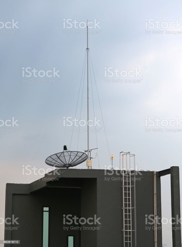 Satellite dish an antenna on roof of building. stock photo