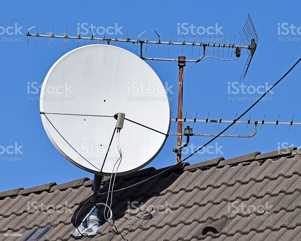 Satellite dish and antenna on the roof stock photo
