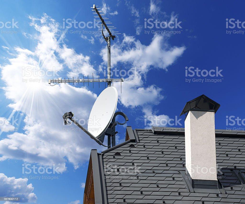 Satellite Dish and Antenna TV on Blue Sky stock photo