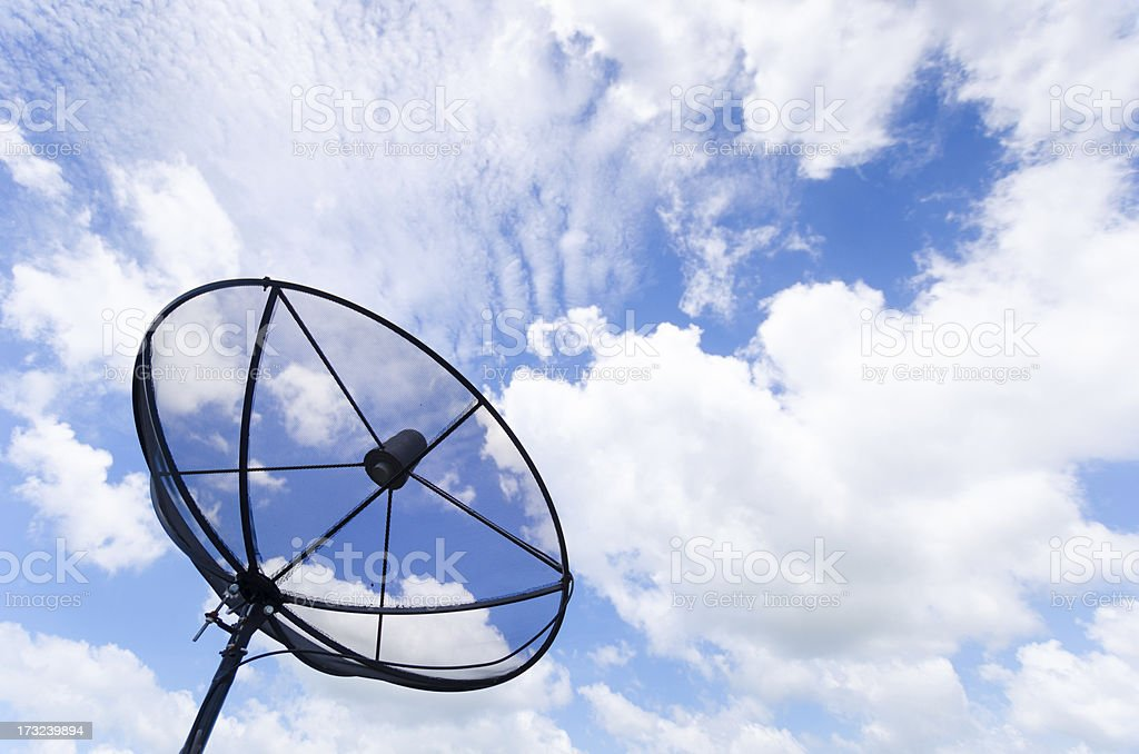 Satellite dish antennas under sky at office building royalty-free stock photo