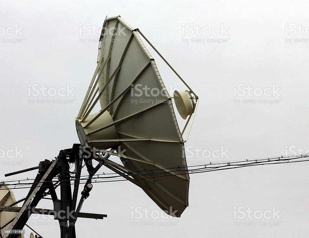 Satellite dish  at a winter sky background royalty-free stock photo