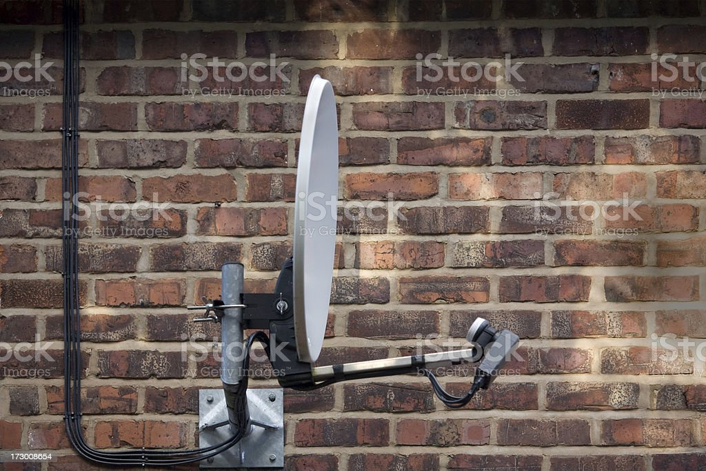 Satellite Dish Attached to Redbrick Wall-See lightbox below for more stock photo