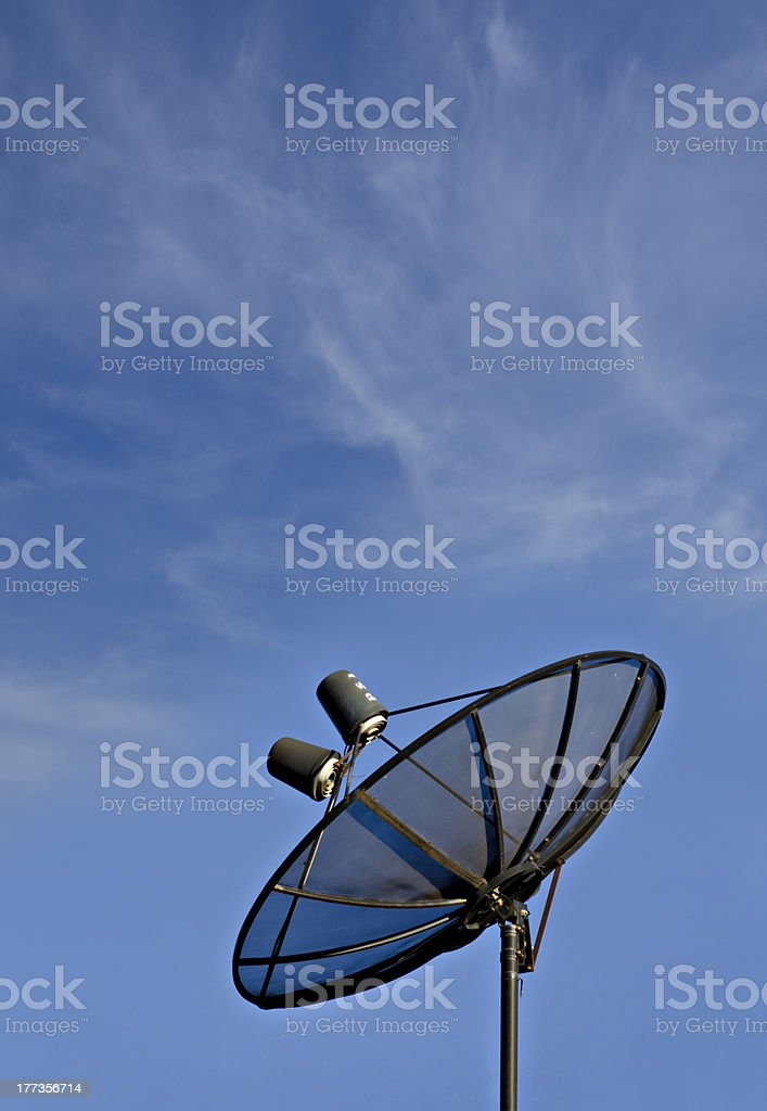 Satellite dish in blue sky royalty-free stock photo