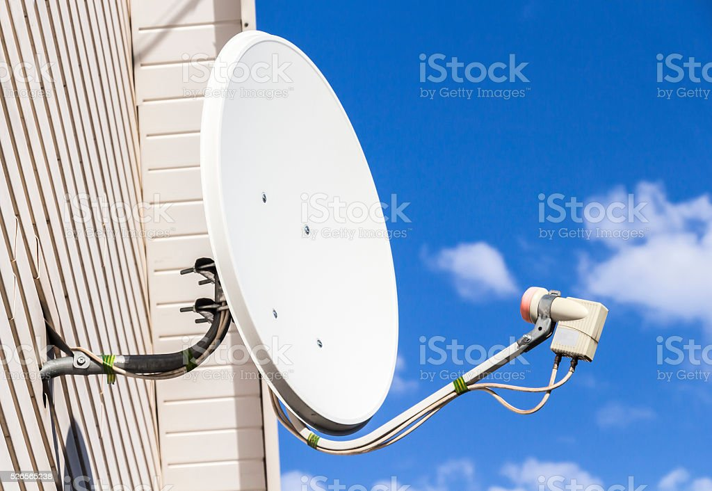 Satellite dish on a house stock photo
